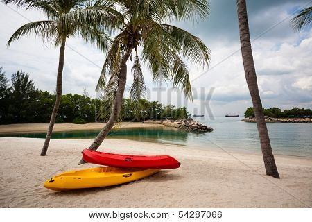 Boats on the beach of Sentosa Island in Singapore.