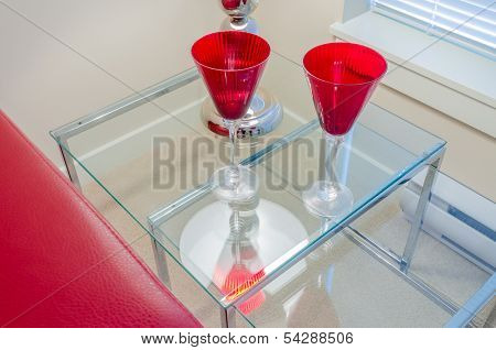 Interior design with lamp and two glasses on end table