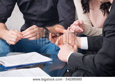people signing a document