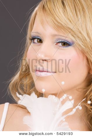 Teenage Girl With Feather
