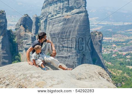 Father and son looking at the town of Kalambaka
