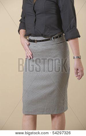 Closeup Of Womens Skirt On Biege Background