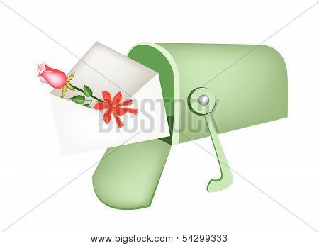 Love Letter And Red Rose In Mailbox