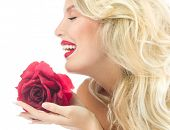 Beauty girl with red rose flower. portrait of attractive caucasian young woman blond, isolated on wh