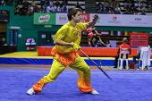 KUALA LUMPUR - NOV 03: Switzerland's Roth Pachlatko performs with a sword in the Men's 'Daoshu' Even