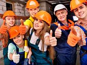 stock photo of overalls  - Happy group people in builder uniform thumb up - JPG