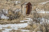 picture of outhouses  - Half wood half rusty metal this outhouse is leaning to the right - JPG