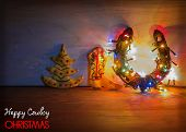 Christmas Card With Horseshoe And Cookies On Wood Background