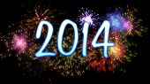 image of solemn  - neon blue new year 2014 with colourful fireworks - JPG