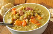 stock photo of peas  - A bowl of split pea soup with ham - JPG