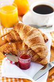 Breakfast With Croissants, Jam, Cup Of Coffee And Orange Juice