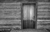 image of humble  - Black and white close up of the front porch of a historic pioneer log cabin - JPG