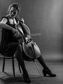 picture of viola  - Photo of a beautiful female musician playing a cello - JPG