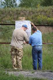 pic of shooting-range  - Two men prepare the purpose for shooting - JPG