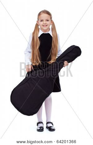 Learning to play a musical instrument - little girl with guitar in textile case, isolated
