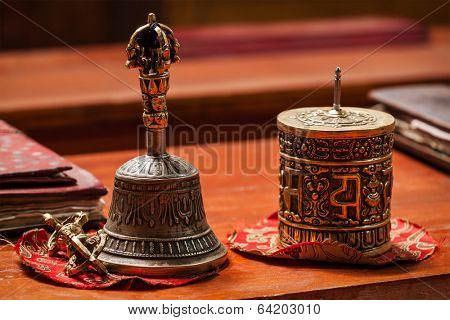Tibetan Buddhist still life - vajra, bell and prayer wheel. Hemis gompa, Ladakh, India.