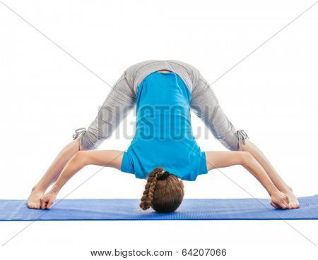 Yoga - young beautiful slender woman yoga instructor doing Wide Legged standing Forward Bend D (Prasarita Padottanasana D) asana exercise isolated on white background
