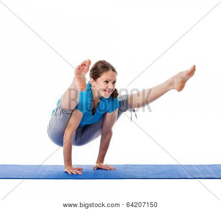 Yoga - young beautiful woman  yoga instructor doing Firefly asana pose (Titibasana) exercise isolated on white background