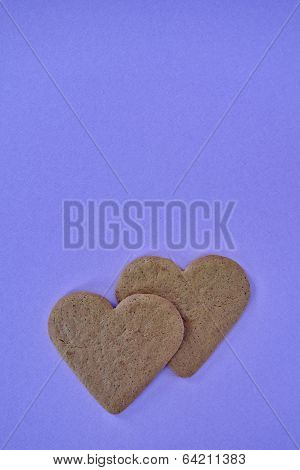 sweetheart shaped cookies on violet  background