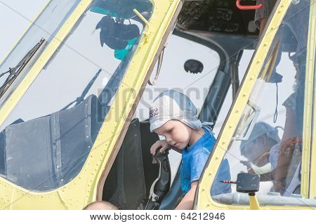Boy sitting in cabin of the MI-8 helicopter