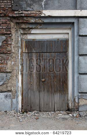 Old, Vintage, Dark, Wooden Door In A Brick Wall.