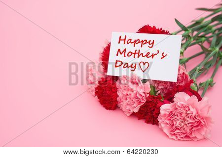 card of happy mother's day with pink and red carnations