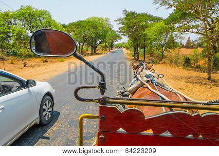 Horse Carriage And Car On Rural Road