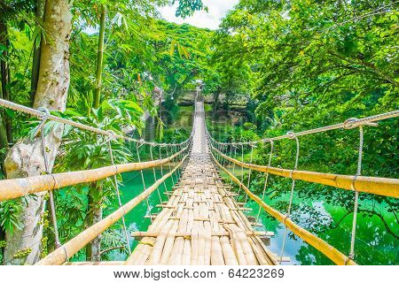 Bamboo Pedestrian Suspension Bridge Over River