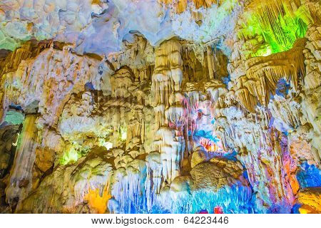 Famous Cave In Halong Bay Illuminated By Colorful Lights