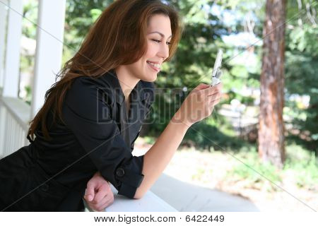 Woman Texting At Home