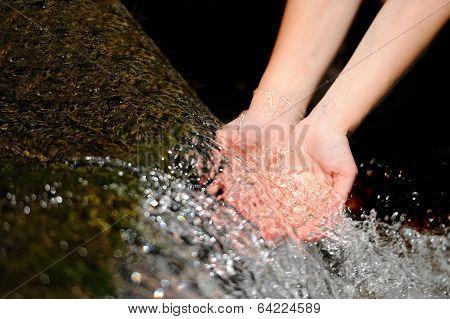 Woman's Hands With Water Splash
