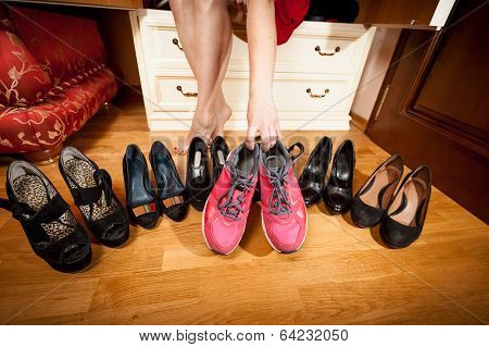 Female Picking Sneakers Rather Than Black Shoes