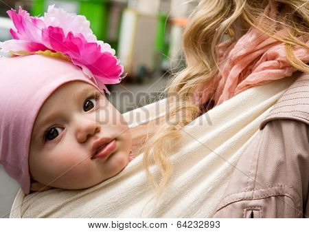 Beautiful Baby Girl Carried By Her Mother In Sling