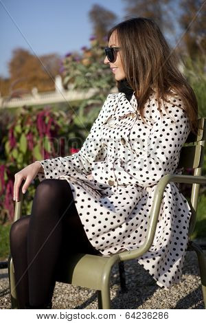 Beautiful Woman In Polka Dot Trench In The Luxembourg Garden Of Paris