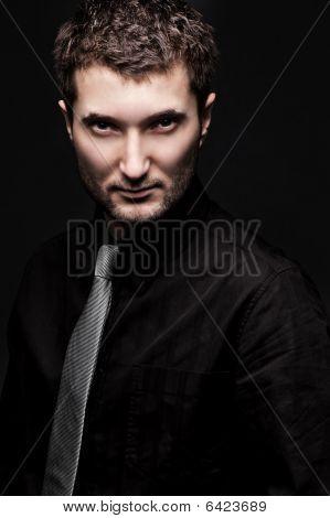 Portrait Of Stylish Man In Black Shirt