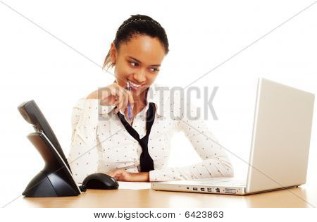 Pretty Woman Smiling And Looking At Laptop