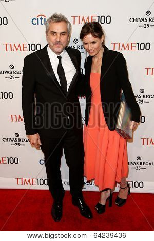 NEW YORK-APR 29: Director Alfonso Cuaron(L) & Sheherazade Goldsmith attend the Time 100 Gala for Most Influential People at Frederick P. Rose Hall at Lincoln Center on April 29, 2014 in New York City.