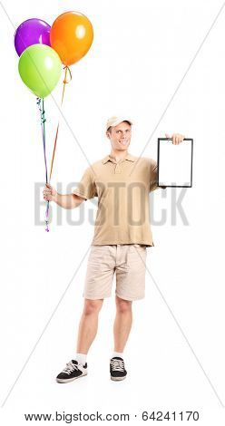 Full length portrait of a delivery boy holding balloons and a clipboard isolated on white background