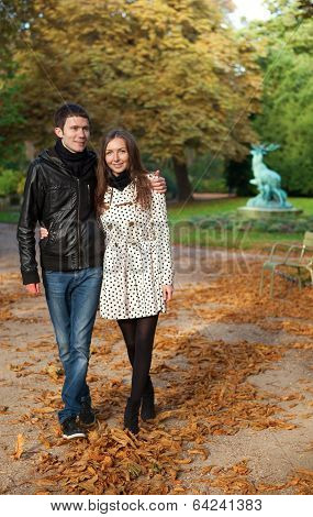 Romantic Coouple In The Luxembourg Garden Of Paris, Walking