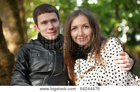 Young Happy Couple Outdoors At Fall
