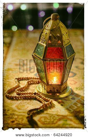 Ramadan lantern and rosary - old photo effect