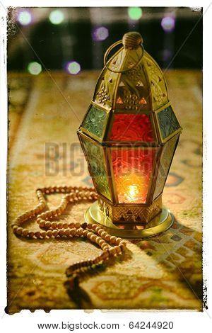 Ramadan lantern and rosary - old photo effect