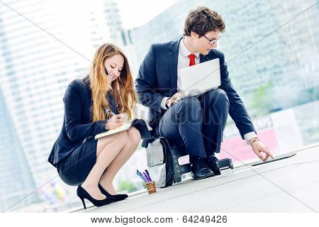 Junior Executives Dynamics Working Outside Of Their Office