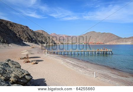 The Secluded Beach And The Gulf Of Aqaba On The Background Of Mountains