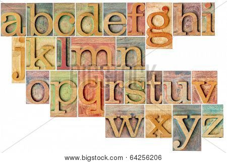 complete English lowercase alphabet - a collage of 26 isolated antique wood letterpress printing blocks, stained by color inks