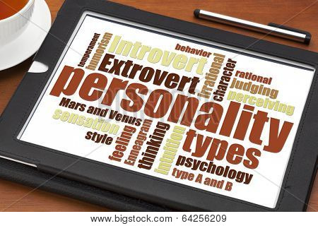 personality types word cloud on a digital tablet with a cup of tea