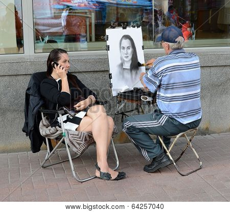 Street Artist Draws A Girl On The Arbat