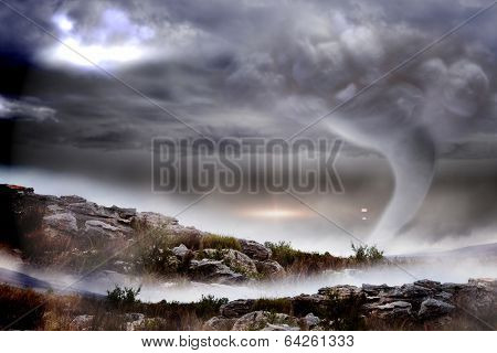 Digitally generated stormy sky with tornado over landscape
