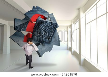 Thinking businessman scratching head against maze graphic on abstract screen in room