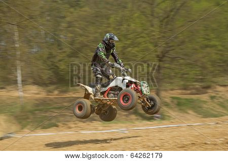 Dynamic Shot Of Quad Racer Jumping